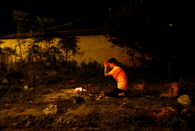A mother prays outside Maotanchang Middle School in Maotanchang town of Luan, Anhui province, China June 3, 2017. (Photo by Jason Lee/Reuters)