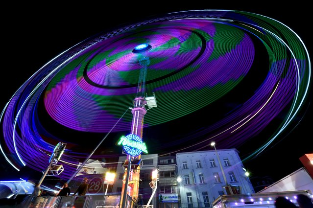 An amusement ride is seen at the Midi Fair, one of the oldest summer events in Brussels, Belgium, in the early hours of August 1, 2015. (Photo by Eric Vidal/Reuters)