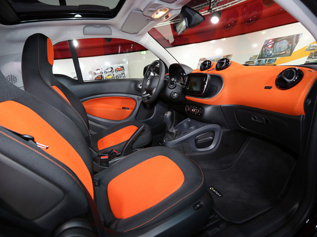 The interior of a Smart ForTwo car is seen at the presentation of the latest models of Daimler's two-seater ForTwo and four-seater ForFour Smart cars on July 16, 2014 in Berlin, Germany. Smart, whose sales fell 10 percent to 46,816 in first half of the year, says that the ForFour will be aimed at young people who would prefer more space than that of the ForTwo. Both cars will be built at the Renault factory in Slovenia. (Photo by Adam Berry/Getty Images)