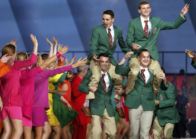 Members of Northern Ireland's team enter the stadium during the opening ceremony for the 2014 Commonwealth Games at Celtic Park in Glasgow, Scotland, July 23, 2014. (Photo by Phil Noble/Reuters)
