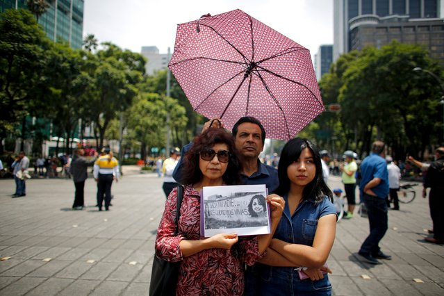 Demonstrators hold a picture showing activist Nadia Vera, who was murdered along photojournalist Ruben Espinosa and three other women, during a protest in Mexico City, August 16, 2015. Espinosa, a prominent Mexican news photographer, was among five people found dead in a middle-class neighborhood of the capital on July 31, 2015. Vera had recently said in a video interview posted online that if anything happened to her or fellow activists, it would be Duarte and the state government's fault. (Photo by Tomas Bravo/Reuters)
