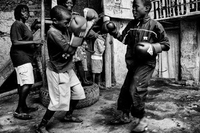 July 27, 2013 – Kampala, Uganda. Kids box at the Rhino Boxing Club, supervised by Helene and Diana. (Photo by Peter Bauza/ZUMA Press/VISUAL Press)