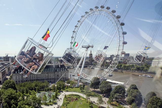 Caitlin Jenkins, 17, (L) and Natascha Newbold, 17, (R) ride the StarFlyer on London's South Bank on July 29, 2014 in London, England. London is currently experiencing a period of warm weather forecasted to continue the rest of this week. (Photo by Dan Kitwood/Getty Images)