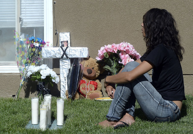 Friends and family mourn at a memorial for sixteen-year-old Jose Izazaga and his 15-year-old sister Abril Izazaga, Thursday, July 7, 2016 in Midvale, Utah. As police search for a man who police say gunned down a teenage brother and sister during an argument over a T-shirt late Wednesday at a Salt Lake City suburb apartment complex, family members are mourning the senseless killing of siblings who shared a tight bond. (Photo by Al Hartmann/The Salt Lake Tribune via AP Photo)