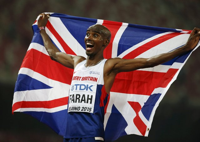 Mo Farah of Britain reacts after winning the men's 10000m event during the 15th IAAF World Championships at the National Stadium in Beijing, China August 22, 2015. (Photo by Lucy Nicholson/Reuters)