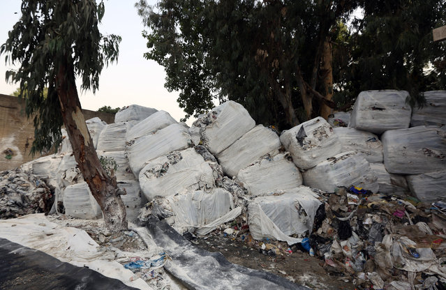 Compressed garbage pile at a dumping site in Beirut, Lebanon, Monday, August 3, 2015. As International celebrities and tens of thousands of Lebanese expatriates arrive in Lebanon amid a flood of summer festivals, the country's own citizens suffocate from mountains of festering garbage collecting on Beirut streets, a reflection of the government paralysis and longstanding inability to find a solution for the capital's rubbish. (Photo by Bilal Hussein/AP Photo)