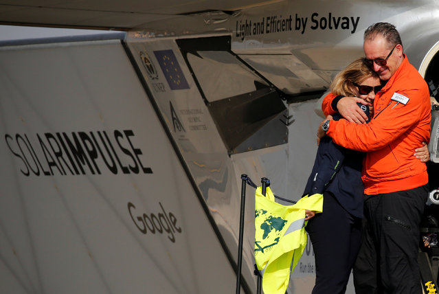 Andre Borschberg, the Swiss pilot of Solar Impulse 2, a solar powered plane, embraces his wife Yasemin after landing at Cairo Airport, Egypt July 13, 2016. (Photo by Amr Abdallah Dalsh/Reuters)