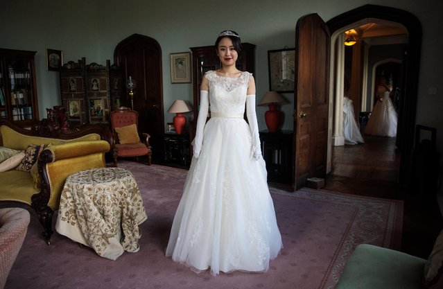 Debutante Jiabao Cui, 24, from Beijing, poses at Boughton Monchelsea Place ahead of the Queen Charlotte's Ball on September 9, 2017 in Maidstone, England. (Photo by Jack Taylor/Getty Images)