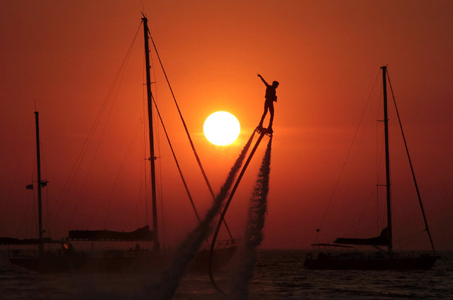 A man practices flyboarding near the village of Olenevka, Crimea August 5, 2017. (Photo by Pavel Rebrov/Reuters)