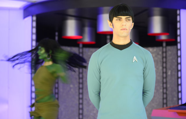 """An actor portraying the """"Star Trek"""" character, Mr. Spock, works at the MAC Star Trek cosmetics booth on day one of Comic-Con International held at the San Diego Convention Center Thursday, July 21, 2016, in San Diego.  (Photo by Denis Poroy/Invision/AP Photo)"""