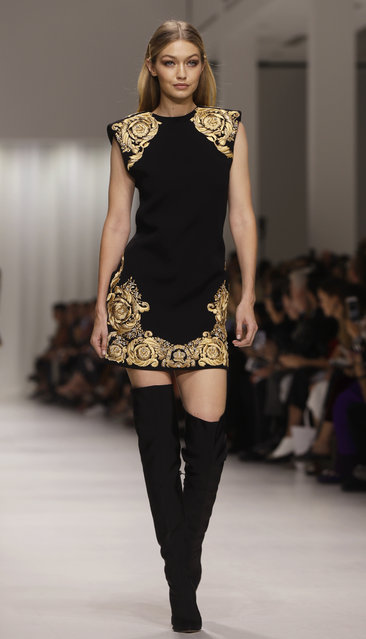 Gigi Hadid wears a creation as part of the Versace women's Spring/Summer 2018 fashion collection, presented in Milan, Italy, Friday, September 22, 2017. (Photo by Luca Bruno/AP Photo)