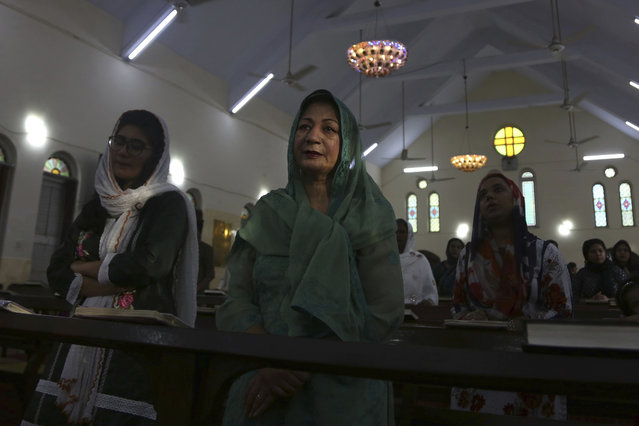 Christians attend an Easter Mass at Central Brooks Memorial Church during a government-imposed lockdown to help stop the spread of the new coronavirus, in Karachi, Pakistan, Sunday, April 12, 2020. (Photo by Fareed Khan/AP Photo)