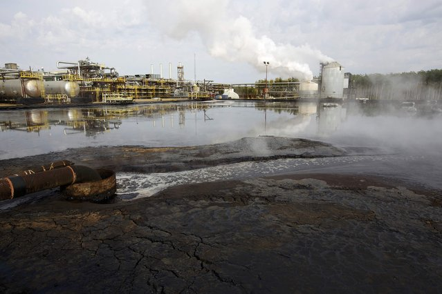 A water treatment pond at the McKay River Suncor oil sands in-situ operations near Fort McMurray, Alberta, September 17, 2014. (Photo by Todd Korol/Reuters)