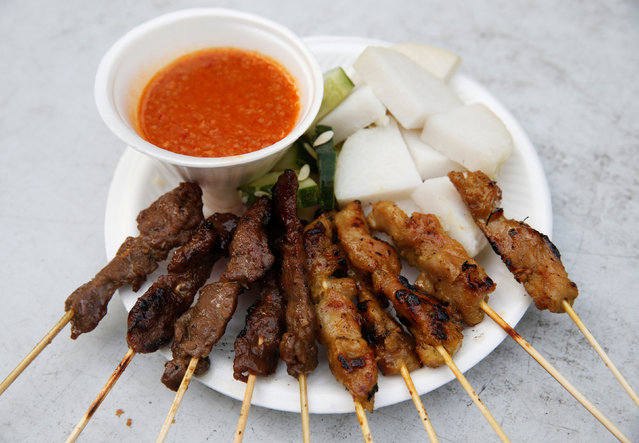 A plate of $5 satay (skewered meat) is seen at Asli Satay Club at Lau Pa Sat food centre in Singapore July 29, 2016. (Photo by Edgar Su/Reuters)