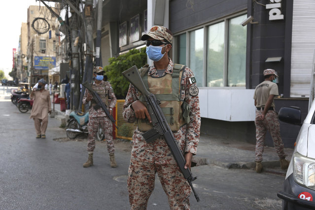 Soldiers stand alert outside a restricted area that is sealed off to control the spread of the coronavirus, in Karachi, Pakistan, Friday, June 19, 2020. (Photo by Fareed Khan/AP Photo)