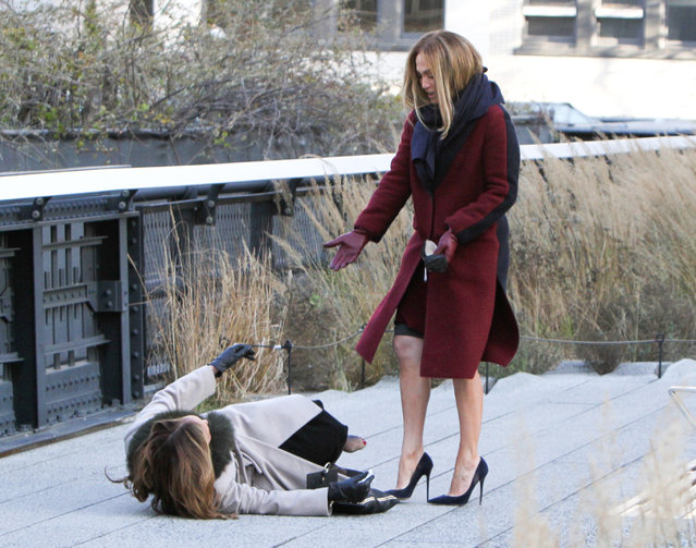 "Jennifer Lopez then helps Leah Remini up on the High Line while filming ""Second Act"" in New York, NY on November 27, 2017. (Photo by Jose Perez/INSTARimages.com)"