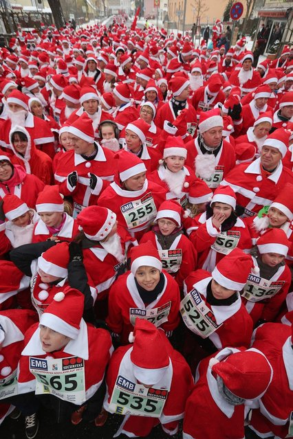 Participants dressed as Santa Claus gather shortly before the 4th annual Michendorf Santa Run (Michendorfer Nikolauslauf) on December 9, 2012 in Michendorf, Germany. Over 800 people took part in this year's races that included children's and adults' races.  (Photo by Sean Gallup)