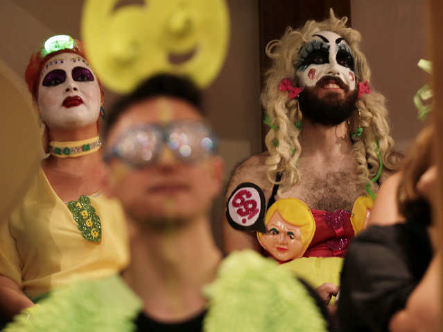 Members of the audience watch the Alternative Miss World contest at Shakespeare's Globe theater in London, October 18, 2014. (Photo by Peter Nicholls/Reuters)
