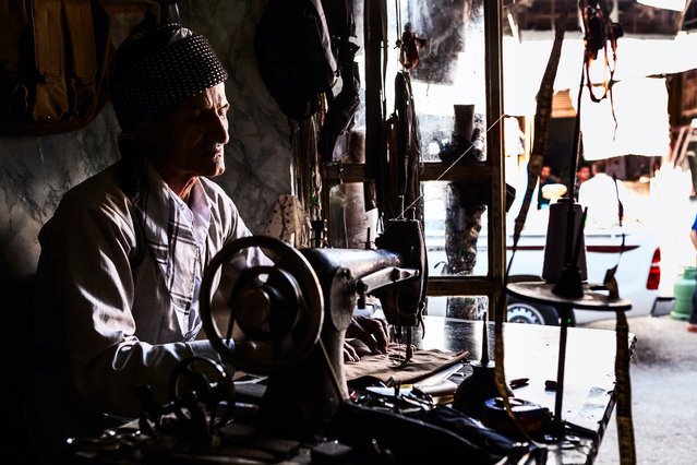 """Patience"". A Kurdish tailor. Photo location: Iraqi Kurdistan, Iraq. (Photo and caption by Juan Aguilar/National Geographic Photo Contest)"