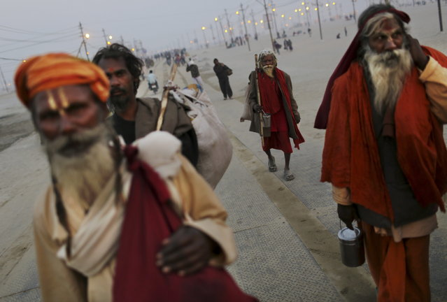 Indian Hindu holy men, or Sadhus, arrive at Sangam, the confluence of the rivers Ganges, Yamuna and mythical Saraswati, ahead of the Maha Kumbh Mela in Allahabad, India, Sunday Jan. 13, 2013. Millions of Hindu pilgrims are expected to take part in the large religious congregation of a period of over a month on the banks of Sangam during the Maha Kumbh Mela in January 2013, which falls every 12th year. (Photo by Kevin Frayer/AP Photo)
