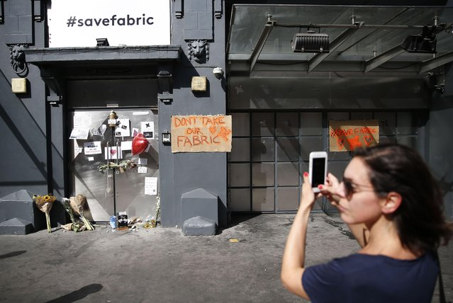 "A woman photographs tributes placed outside the Fabric nightclub in London, Britain September 8, 2016. One of London's biggest nightclubs will appeal against a council's decision to revoke its licence, it has been confirmed. Fabric nightclub, based in Farringdon, faces closure after Islington council concluded that it had a ""culture of drug use"" which staff were ""incapable of controlling"". A spokesman for the venue confirmed that it had decided to appeal against the council's decision, made in the early hours of Wednesday morning. The closure of the club has been met with fierce criticism by both politicians and figures from the world of music. (Photo by Neil Hall/Reuters)"