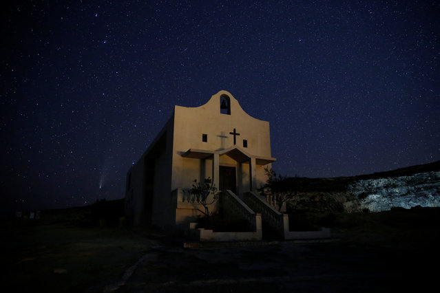 "The Comet C/2020 or ""Neowise"" is seen behind St Anne Chapel at Dwejra, outside the village of San Lawrenz on the island of Gozo, Malta on July 22, 2020. (Photo by Darrin Zammit Lupi/Reuters)"