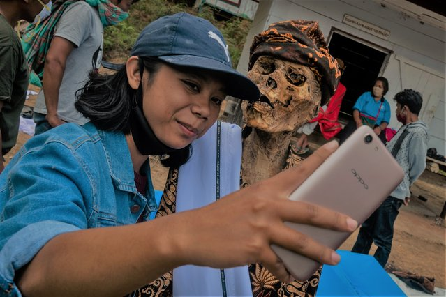 "Iin Arensia taking a selfie with his grandfather preserved body Ne Potta during a traditional ritual called ""Manene"" in Panggala, Nort Toraja, South Sulawesi, Indonesia, Tuesday, August 25th 2020. (Photo by Hariandi Hafid/ZUMA Wire/Rex Features/Shutterstock)"