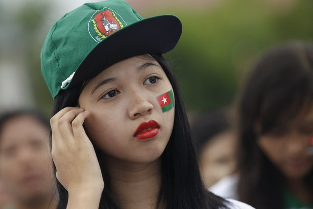 A supporter is seen with a USDP flag sticker during Myanmar's ruling Union Solidarity and Development Party (USDP) campaign rally in Yangon, Myanmar October 10, 2015. (Photo by Soe Zeya Tun/Reuters)