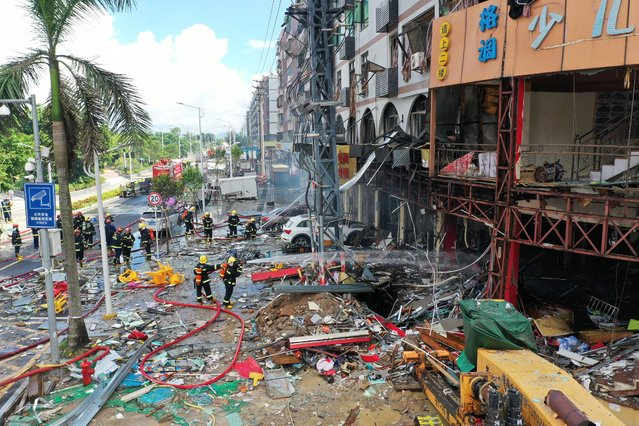 Firefighters work at the scene of an explosion in Zhuhai, in China's southern Guangdong province on September 11, 2020. At least three people were injured on September 11 when a gas pipe exploded in a store in the southern city of Zhuhai, local officials said. (Photo by AFP Photo/China Stringer Network)