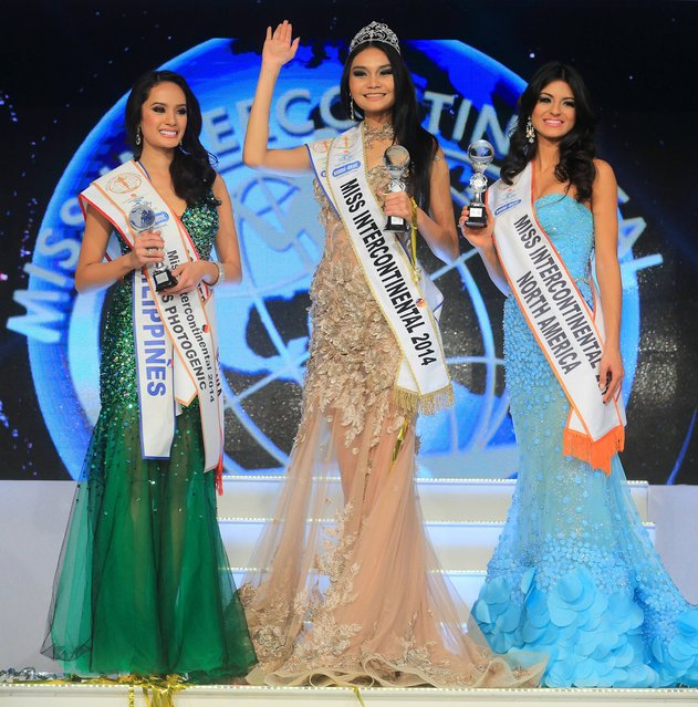 In this December 4, 2014 picture the winner of the Miss Intercontinental  2014 beauty  contest,  Wang Patraporn, from Thailand, center, is framed by second placed Kris Tiffany Janson  of the Philippines, left, and third placed  Jeslie Mergal  from Cuba, right, in Magdeburg, eastern Germany. (Photo by Jens Wolf/AP Photo/DPA)