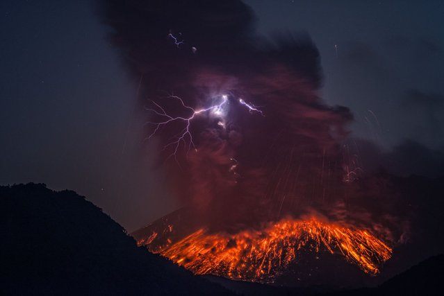 Lightning can be seen emerging through the lava eruption. Images were captured on February, 24 2013, around 4.50am, 3-4km east of the volcano in the Kaghoshima area of South Japan. (Photo by Martin Rietze/Guzelian)