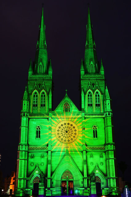St Mary's Cathedral is illuminated as part of a Christmas lights display in celebration of Christmas on December 19, 2014 in Sydney, Australia. (Photo by Brendon Thorne/Getty Images)