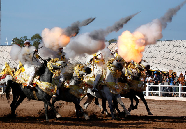 Horse riders perform with guns during the El-Jadida International Horse Show in El-Jadida, south of Casablanca, Morocco, October 15, 2016. (Photo by Youssef Boudlal/Reuters)