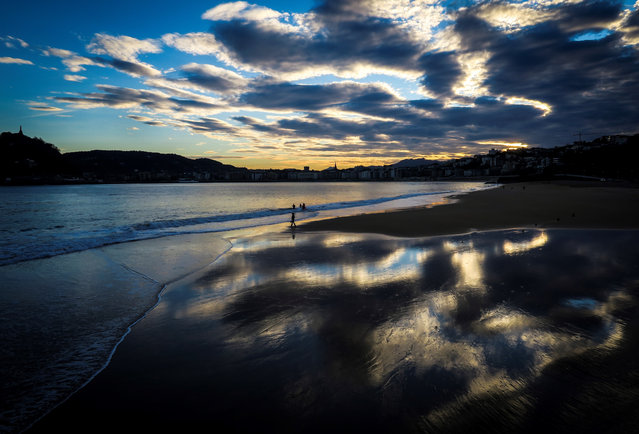 A person walks along Ondarreta Beach in San Sebastian, Spain, 02 November 2020. (Photo by Javier Etxezarreta/EPA/EFE)