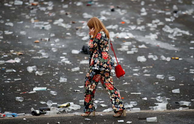 General view of a racegoer surrounded by litter during Ladies Day at the Grand National Festival at Aintree Racecourse on April 13, 2018 in Liverpool, England. (Photo by Jason Cairnduff/Action Images via Reuters)