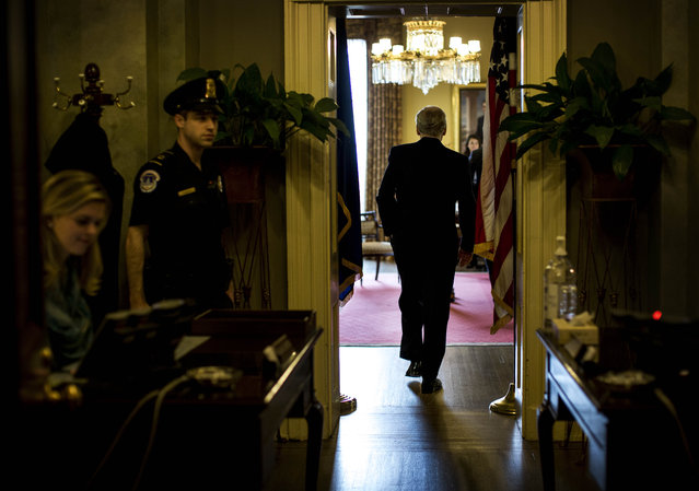 Newly elected Senate Majority Leader  for the 114th Congress, Senate Minority Leader Mitch McConnell (R-KY) walks into his office on Capitol Hill in Washington, DC Thursday, November 13, 2014. (Photo by Melina Mara/The Washington Post)