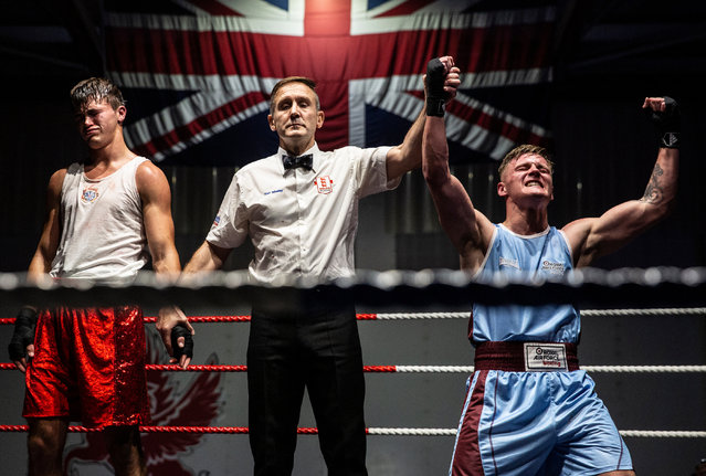 Personnel, 3rd place. RAF Odiham military boxing evening: SAC Brad Axe, an RAF firefighter based at RAF Odiham, celebrates having won against a local fighter called Micky. (Photo by Cpl Rob Travis/2020 RAF Photo Competition)