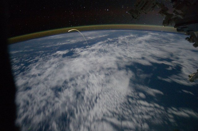 A member of the Expedition 28 crew aboard the International Space Station caught this spectacular photo of a lifetime, showing space shuttle Atlantis actually hurtling through the Earth's atmosphere on its way back to Kennedy Space Center, Florida, July 21, 2011. (Photo by NASA/Johnson Space Center)