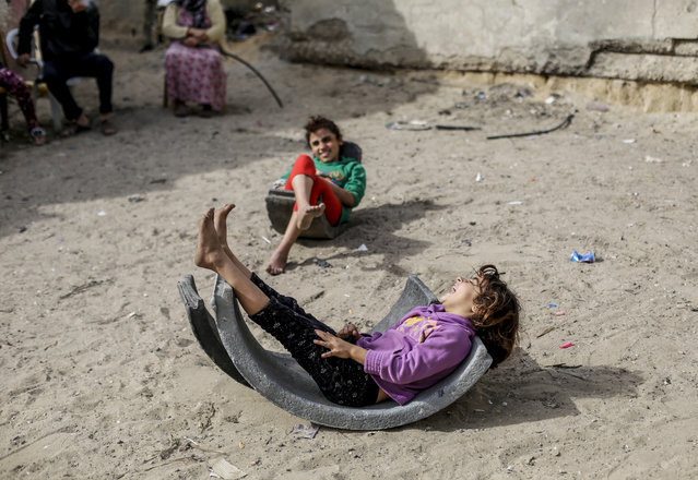 Palestinian children play outside their home in Beach camp in the western Gaza Strip on December 14, 2020. (Photo by Mahmoud Issa/SOPA Images/Rex Features/Shutterstock)