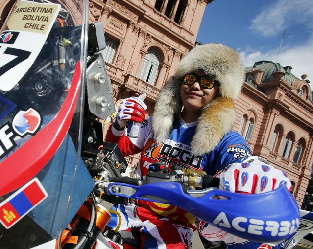 Anar Chimbaatar, of Mongolia, rides her KTM motorcycle during the departure ceremony of the Dakar Rally 2015 in front of the Casa Rosada Presidential Palace in Buenos Aires January 3, 2015. (Photo by Jean-Paul Pelissier/Reuters)