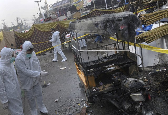 Pakistani investigators examine the site of bomb explosion in Rawalpindi, Pakistan, Friday, December 4, 2020. A roadside bomb exploded near a busy bus terminal in the Pakistani garrison city of Rawalpindi, killing and and wounding some persons, police said. (Photo by A.H. Chaudary/AP Photo)