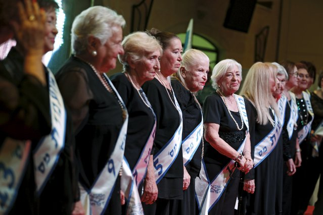 Holocaust survivors stand on a stage during a beauty contest for survivors of the Nazi genocide in the northern Israeli city of Haifa, November 24, 2015. (Photo by Amir Cohen/Reuters)