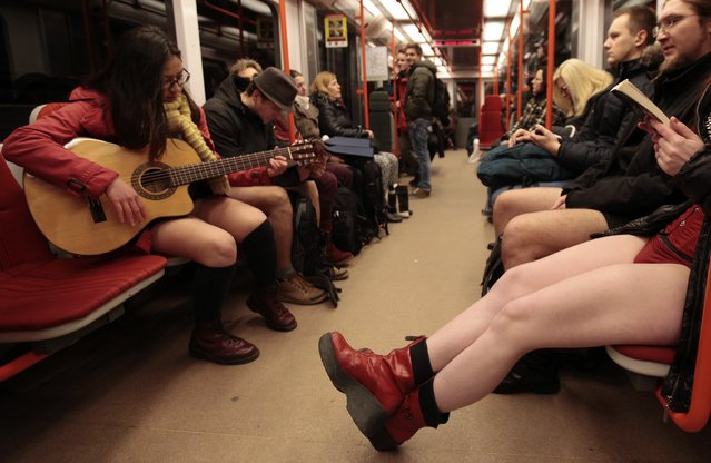 """Passengers not wearing pants sit on a subway train during the """"No Pants Subway Ride"""" in Prague January 11, 2015. (Photo by David W. Cerny/Reuters)"""