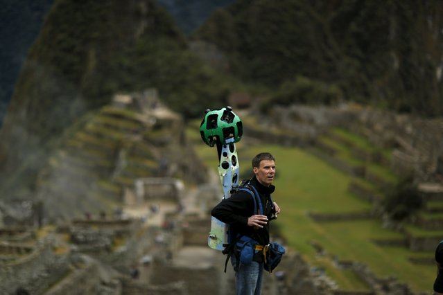 Daniel Filip, Tech Lead Manager for Google Maps, carries the Trekker, a 15-camera device, while mapping the Inca citadel of Machu Picchu for Google Street View in Cuzco, Peru, August 11, 2015. (Photo by Pilar Olivares/Reuters)