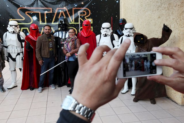 People dressed as Star Wars characters pose for a photograph during a Star Wars fan convention in Ciudad Juarez, Mexico December 5, 2015. (Photo by Jose Luis Gonzalez/Reuters)
