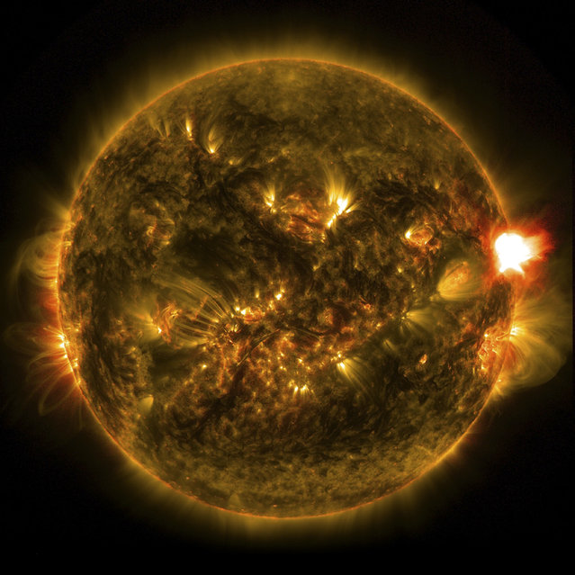 A mid-level solar flare is seen in an image from NASA's Solar Dynamics Observatory on January 12, 2015. Harmful radiation from a solar flare cannot pass through Earth's atmosphere to physically affect humans on the ground, however – when intense enough – they can disturb the atmosphere in the layer where GPS and communications signals travel, according to NASA. (Photo by Reuters/NASA/SDO)