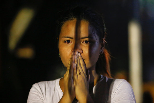 A woman cries at the site where a man was killed by two motorcycle-riding gunmen in Manila, Philippines early October 29, 2016. (Photo by Damir Sagolj/Reuters)