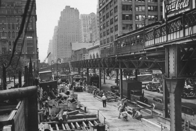 """Work begins for an underground replacement for the Sixth Avenue """"El"""" (elevated train), shown looking north from 42nd Street, July 28, 1936. The El is to be demolished in 1939. (Photo by AP Photo/HS)"""
