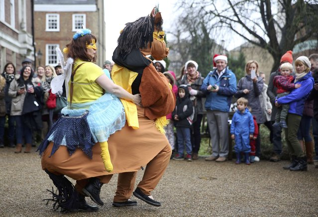 Participants perform a dance in costume  before the start of the annual London Pantomime Horse Race in Greenwich, Britain December 13, 2015. (Photo by Neil Hall/Reuters)