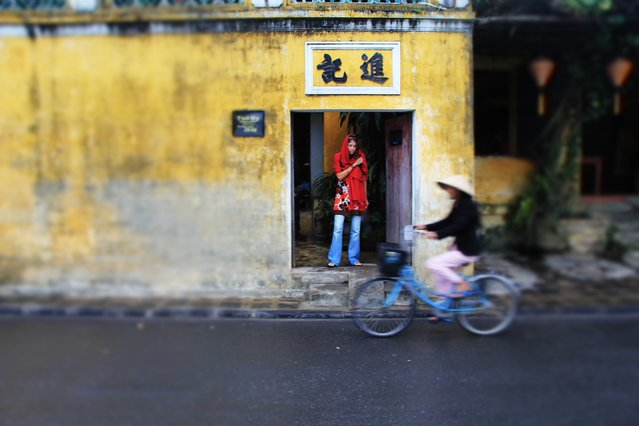 """Hoi An, Vietnam"". I captured this photo of my girlfriend as she paused exiting a shrine. Among the hustle and bustle of Vietnam. (Photo and caption by David Elmore/National Geographic Traveler Photo Contest)"